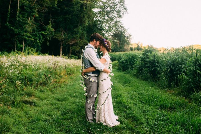 couple wrapped in flower garland