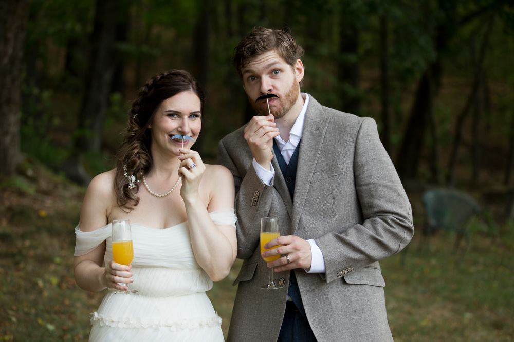 couple with fake mustaches