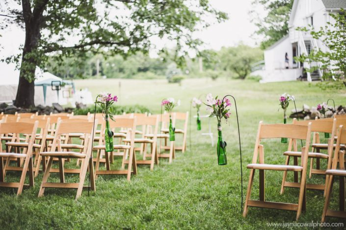 wedding seating with flowers in hanging vases