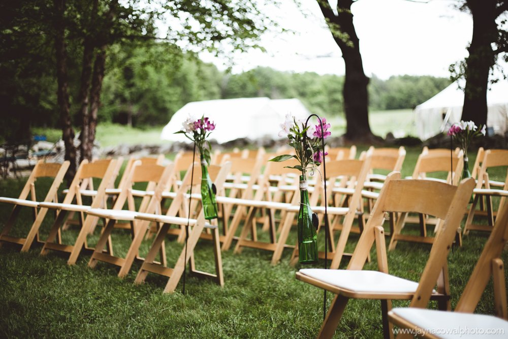 wedding seating with flowers in vases
