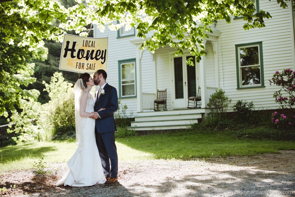 kissing under the local honey sign