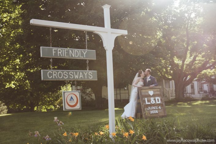 couple with wedding sign
