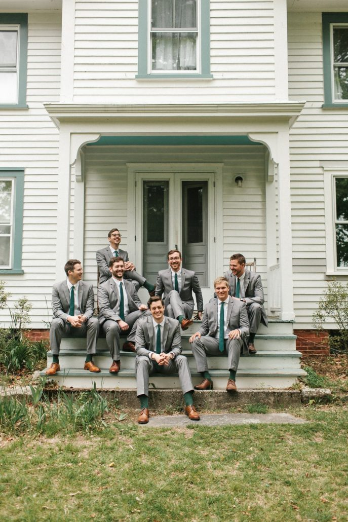 groom and groomsmen sitting on porch