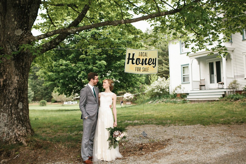 couple under local honey sign