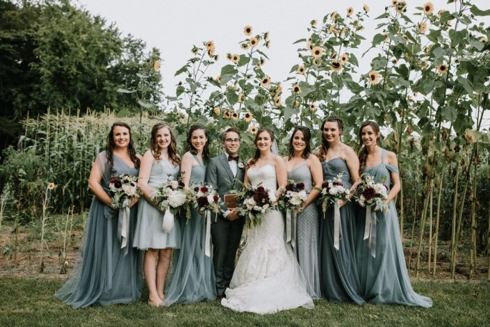 bridal party by sunflowers