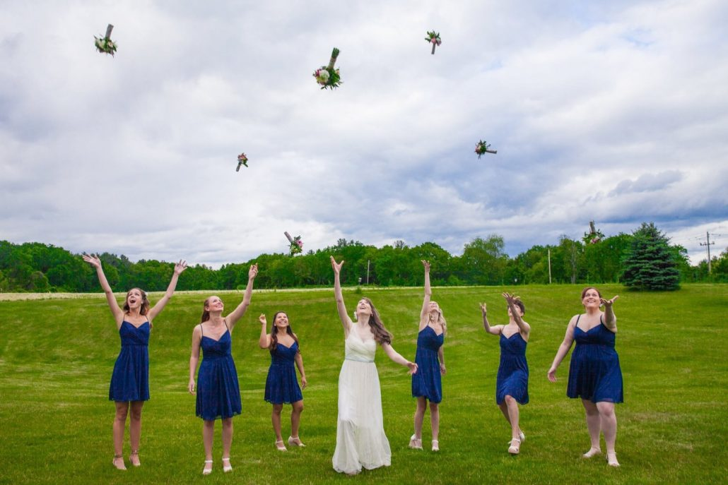 bride and bridesmaids tossing bouquets